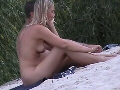 Cute blonde with pointy tits in this candid beach video