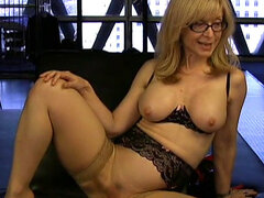 Mature babe in nylon stockings plays with pussy