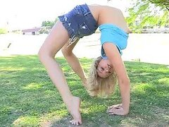 Hot and Flexible Blonde Girl Showing Her Skills and Boobs in the Park