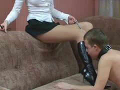 He worships her leather boots on a leash