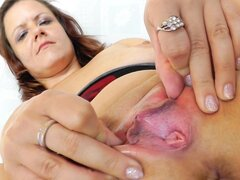 Mature Dzamila is stretching her shaved pussy