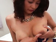 Slutty Japanese MILF exposes her big milky boobs