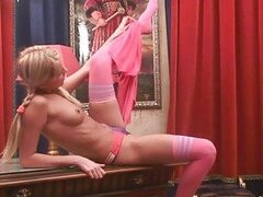Naughty sexy blonde teen with braids wearing stockings does striptease