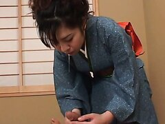 Shy Japanese geisha works with her hands