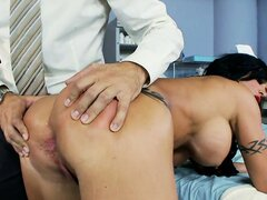 The naughty nurse's booty gets spanked and oiled up by the horny doctor