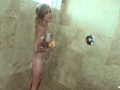 Gorgeous blonde displays her sensational ass and lovely tits in the shower