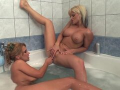 Dorothy Black is getting a blowjob from her lesbian girlfriend in the tub
