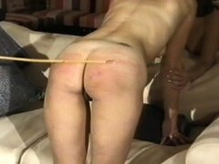 Asses spanked and caned in fetish video