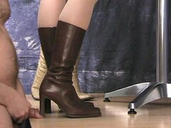 Cock crushed under sexy girls' boots