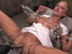 Sexy blonde bitch has her tits suctioned and her twat fucked by a randy robot