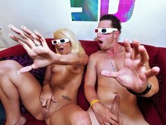 A kinky, sex loving couple fool around on the couch while watching a 3D movie