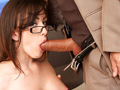 A sexy secretary with glasses on gives in and finally fucks her boss' boner