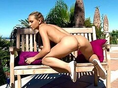 Blonde cutie pleasuring her ass and pussy on a bench