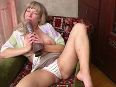 Milfy Mila with big saggy tits  plays with adult toy