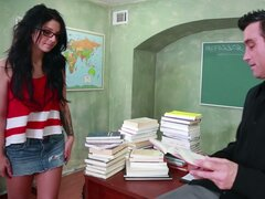 Horny black haired student Madelyn Monroe gives a stout blowjob to her teacher