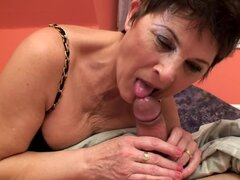 Lewd granny Margo T. sucks a dick and gets fucked in cowgirl position