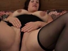 Cute and chubby brunette cougar dildoing herself in the pussy