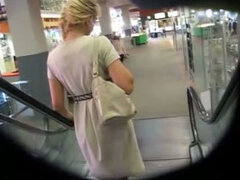 Spying on sexy blonde girl exposing beautiful upskirt view