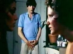 A raunchy retro scene as a guy walks in on two hotties kissing and he joins in