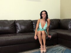 Busty brunette Ava Addams puts on a live show and starts undressing
