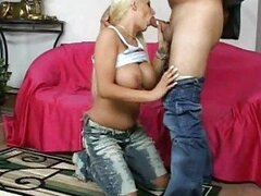 Busty tanned blonde in jeans doing deep throat action