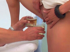 Nurse is pissing in the glass
