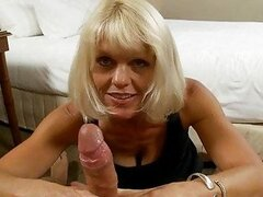 Handsome blonde cougar in black dress sucks hard boner