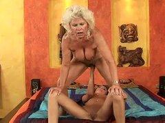 Blonde granny Effie gets her pussy fisted by some pretty girl