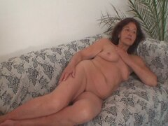 Naughty granny takes two young dicks