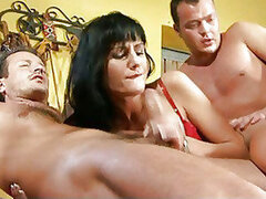 A lovely looking mature mom shows she's still got it as she rides two guys
