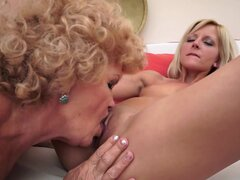Curly-haired mom is licking that young puss