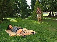 Hot brunette rests on the grass in the forest and gets fucked