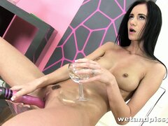 She shoves the dildo in her cunt while she drinks her piss and spreads
