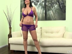 Lisa Ann stripping off her shear purple lingerie showing off her big tits