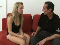 Sexy blonde Naomi chats on the couch and lets an old guy suck titty