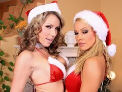 Two beautiful blonde babes dress up for christmas and give each other a present.