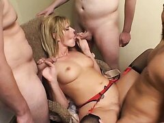 Blonde mature has fun with her husband's friends in the hotel room