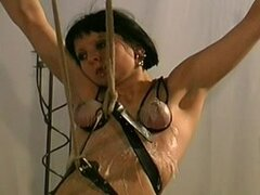 Helpless and hot brunette with gag in her mouth wants her master to be brutal