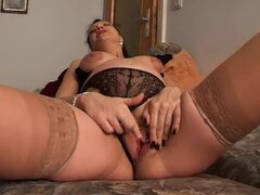 Pregnant brunette wears sexy black panties