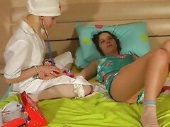 Blonde lezzie in nurse outfit shares dildo with her lesbian friend