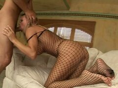 Footjob From Whore In Fishnet Outfit