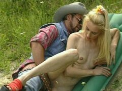 Tiny blonde fucks cowboy in the fields!