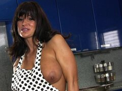Outstanding tanned star Lisa Ann in the kitchen!