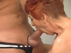 He nails mature redhead in the office