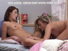 A brunette and a blonde teen having lesbo sex
