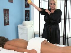 Brunette babe receives a sensual massage from this nasty blonde masseuse