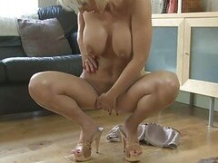 Sensual blonde momma with big tits in heels masturbates with dildo
