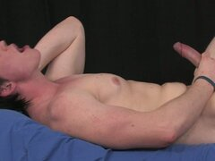 Cute young gay stud strips off his clothes and jerks big cock
