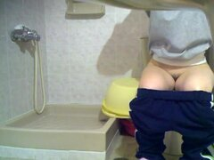Girl got on toilet cam sitting on the bowl and flashing nub