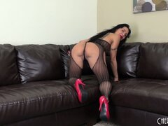 Gorgeous milf Mahina Zaltana displays her huge tits and big round ass on the sofa